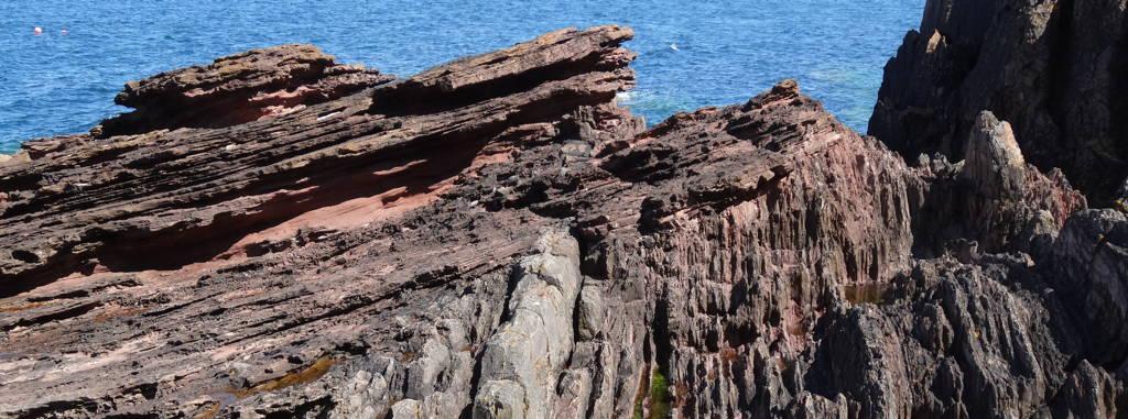 Outcrop of an angular unconformity at Siccar Point near Dunbar, Scotland.